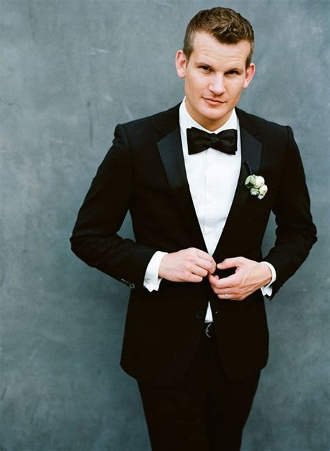 groom in black suit and black bow tie s n a z z y m a