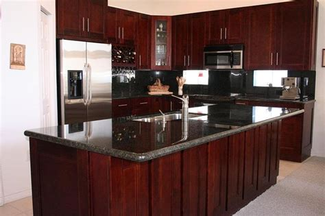 dark cherry wood kitchen cabinets 17 best ideas about cherry wood kitchens on pinterest