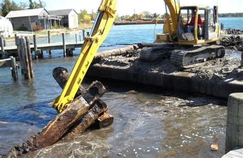 driving boat michigan dredging services for the great lakes
