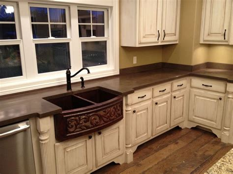 Brown Countertops White Cabinets by Brown Concrete Countertops Backsplash With White Cabinets