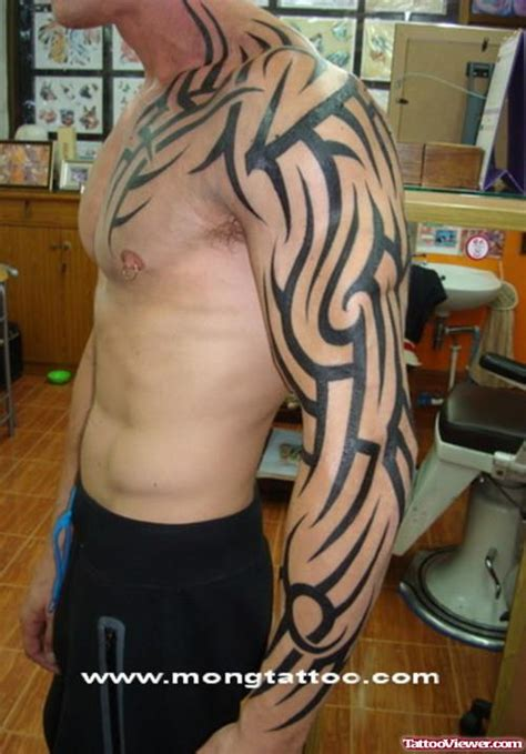 tattoo full hand tribal red ink tribal tattoo on man chest and left sleeve