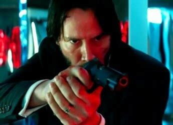 what tattoo does john wick have on his back is holding a gun sideways like how john wick holds his