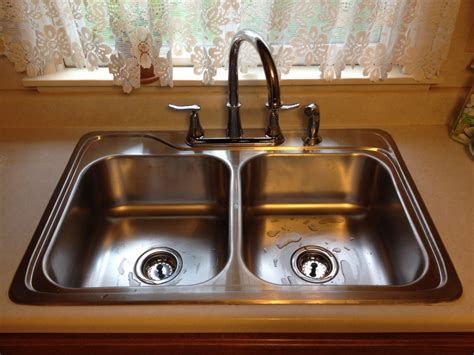 how to install faucet in kitchen sink stainless kitchen sink installation antwerp ohio