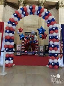 white and blue veterans day balloon arches at union