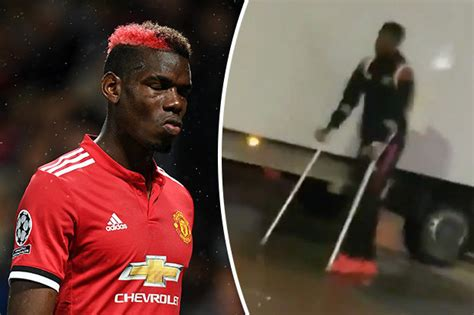 man united star paul pogba man utd news paul pogba filmed on crutches after