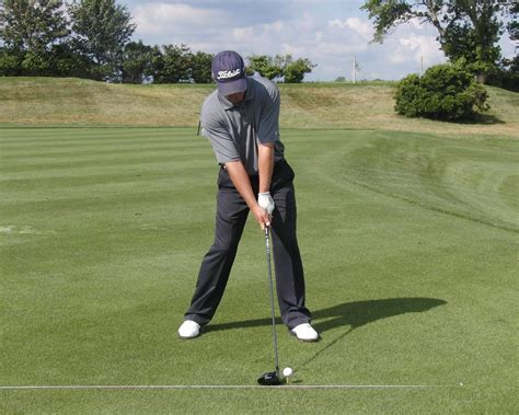 how to set up golf swing hitting up or down here s how to set up
