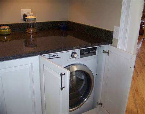 cabinet washer and dryer stow away with custom cabinets plain fancy cabinetry