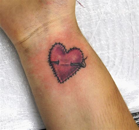 beautiful heart tattoo design for girls the sing of love