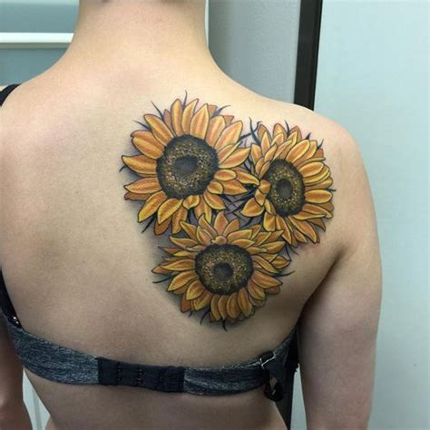 tribal sunflower tattoo tribal and realistic sunflower on right hip