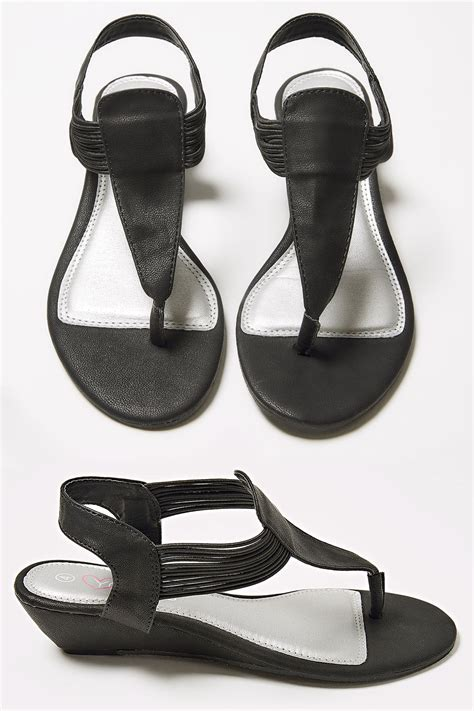 what is lights out rated black low wedge elasticated toe post sandal in eee fit