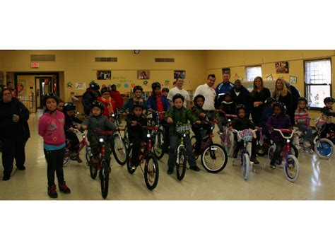 sterling house stratford two wheels organization gives 25 bikes to 25 stratford children at sterling house