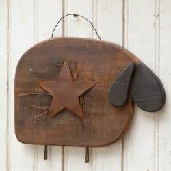 Primitive and rustic wood sheep with heavy wire hanger and rusty star