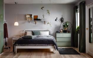 Small bedroom furnished with a bed for two in white metal with