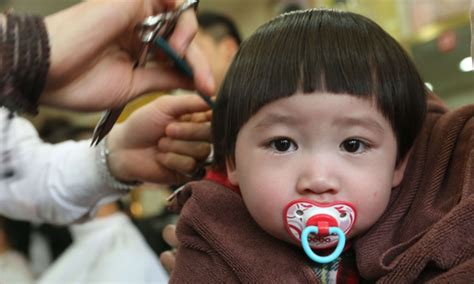 chinese children haircut dragons heads and lucky haircuts in china in pictures