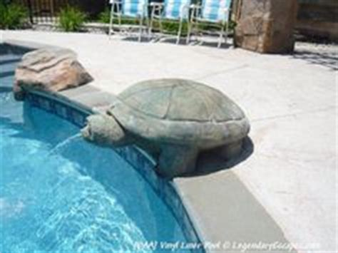 tattoo liner spitting turtle fountain on a swimming pool these are awesome for