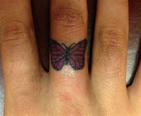 tattoo butterfly finger butterfly finger tattoo finger hand tattoos pinterest