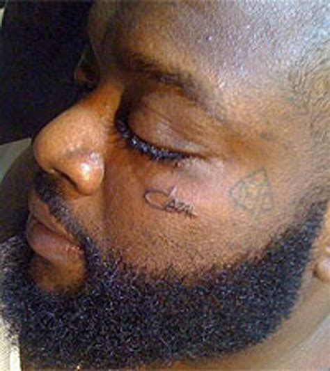 rick ross tattoos cazal logo on his face