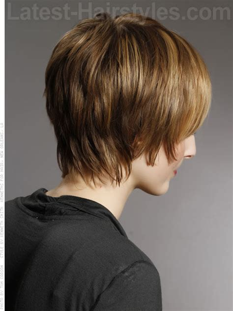the backs of womens short haircuts shaggy chic layered highlighted hair with bangs back view