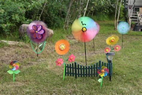 lawn ornaments lawn ornaments pinwheel spinners free stock photo