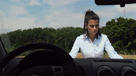 woman driver on the phone for car breakdown woman female driver emergency and driving problems
