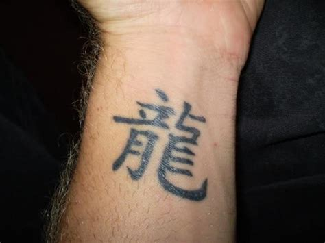 tattoo on wrist meaning wrist tattoos for men tattoos art