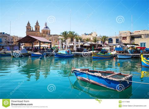 boat dealers malta marsaxlokk market with traditional colorful fishing boats