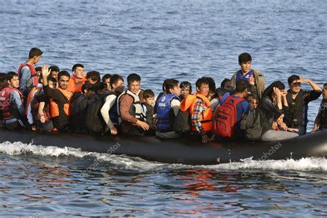 refugee on boat refugee migrants arrived on lesvos in inflatable dinghy