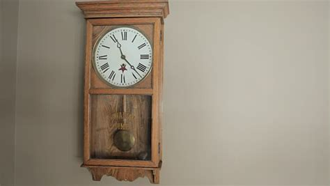 grandfather clock pendulum stops swinging old pendulum grandfather clock on a green screen