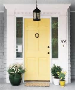 gray house yellow door yellow door home bungalow beautiful inspiration