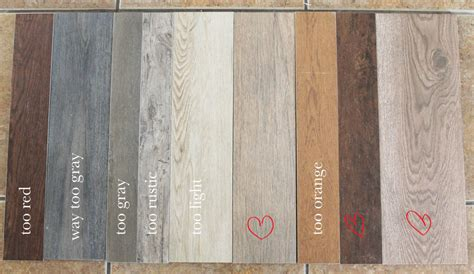 this is what i want the tile wood combo in the entryway our flooring solid wood vs faux wood tile chris loves