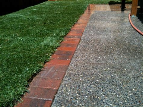 Brick Patio Edging by Brick Edging On Concrete Green S Landscaping Llc