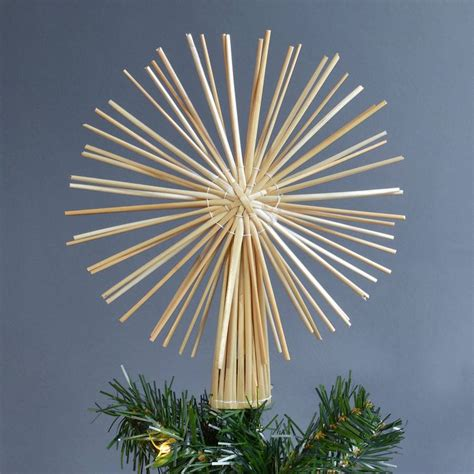 straw star christmas tree topper by winter s moon