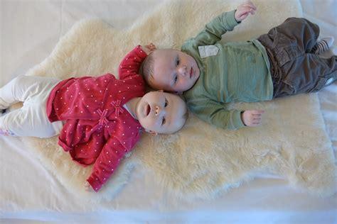 lambskin baby rug two babies on lambskin rug lambcare