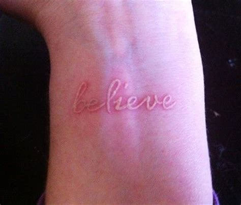 small wrist quote tattoos one word on wrist believe on wrist white