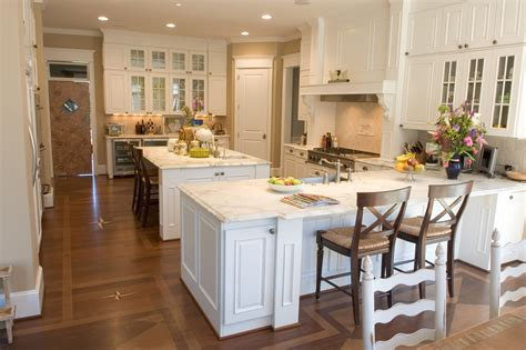 kitchen with island and peninsula when to choose a peninsula over an island in your kitchen