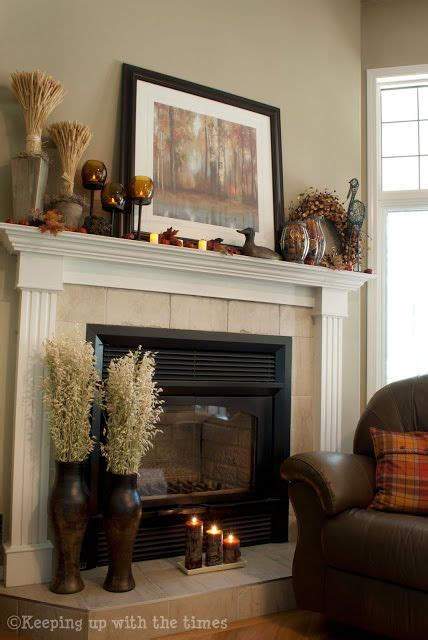 keeping cats from mantel decorations and trees fall mantle decor idea keeping up with the times i like the oats on the vases at the base