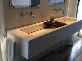one large sink with two faucets for bathroom