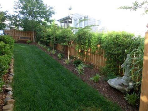 fenced backyard landscaping ideas images of small trees for along a fence line in michigan