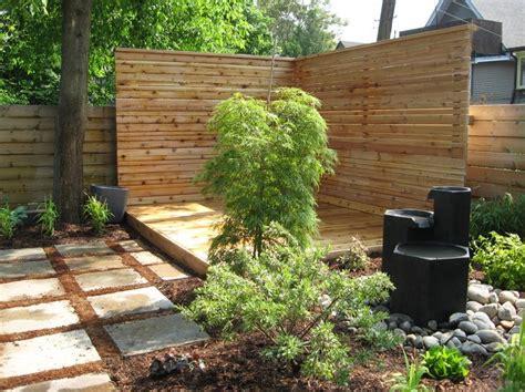 backyard fence ideas landscape modern with bark mulch