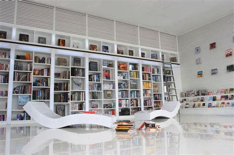 modern small home library with l shaped white glaze wooden