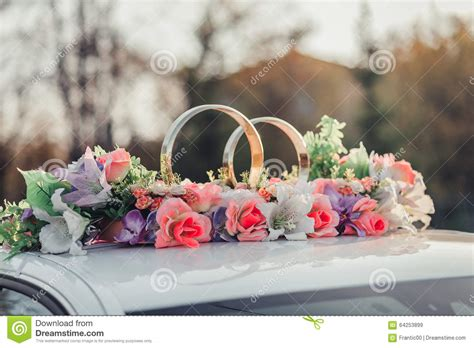 Wedding Car With Flowers by Wedding Car Decoration With Flowers And Golden Rings Stock