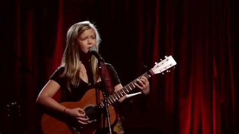 who is the singer playing guitar in the direct tv commercial may 2016 emily elbert finalist of guitar center s singer
