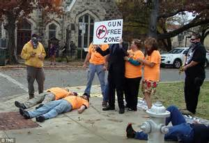 Pro gun advocates stage mock mass shooting outside the university of