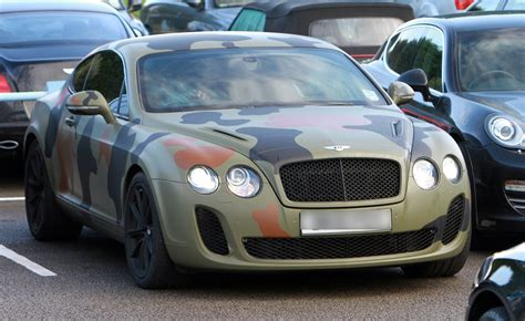 bentley camo mario balotelli with his camouflage car leaving manchester