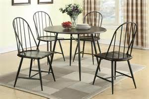 Iron Dining Room Table Furniture Black Iron Dining Table With Four Chair Placed On Brown Plaid Carpet As Well As