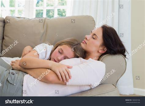 mom on sofa mother daughter sleeping on sofa home stock photo