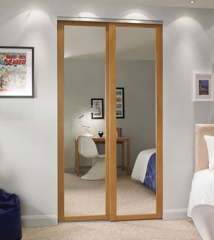 Howdens Wardrobes - oak shaker panel mirror door howdens joinery