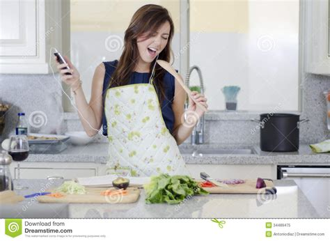Singing In The Kitchen by In The Kitchen Royalty Free Stock Photo Image