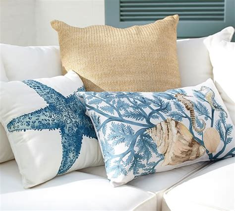 the art of pillow arrangements seaside interiors coastal pillow pottery barn cushions blue outdoor pottery