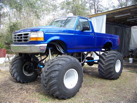 monster truck videos in mud massive blue lifted ford monster f 150 truck ford f150
